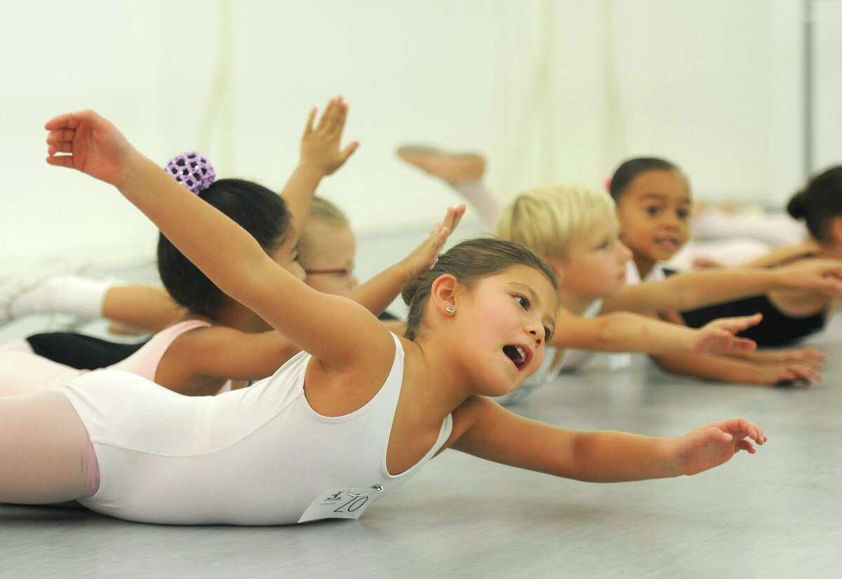 Stamford's Lielle Chu, 6, stretches during children's auditions for