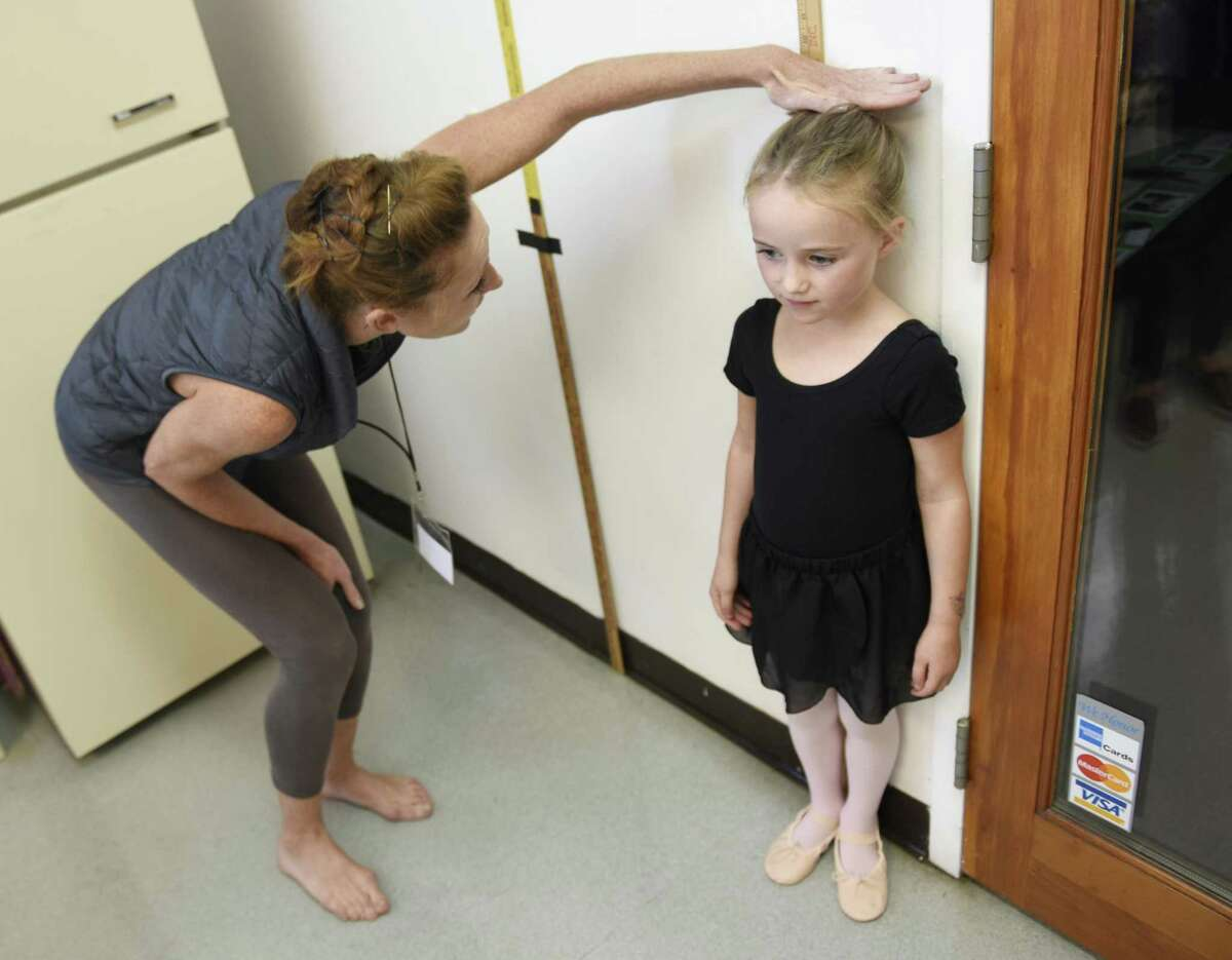 Darien's Sadie Haverstick, 5, gets measured before auditioning for