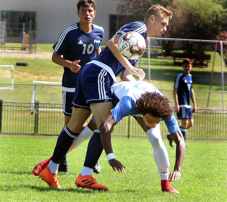 Lewis and Clark's Reshaun Walkes, right, and Alem Sabic of St. Louis Community College collide during first half action Sunday at Tim Rooney Field. LCCC won 2-1 Photo: Pete Hayes | The Telegraph