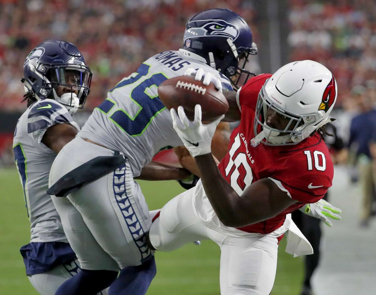 Star safety Earl Thomas suffered a lower leg fracture in the Seahawks' victory over the Arizona Cardinals on Sunday.