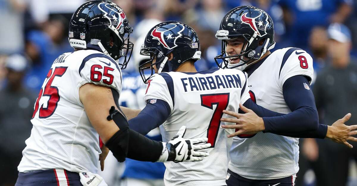 Houston Texans kicker Ka'imi Fairbairn (7) is embraced by center Greg Mancz (65) and holder Trevor Daniel (8) as they celebrate Fairbairn's 37-yard field goal to beat the Indianapolis Colts 37-34 in overtime at Lucas Oil Stadium on Sunday, Sept. 30, 2018, in Indianapolis.
