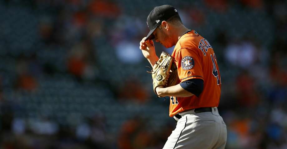 Houston Astros relief pitcher Brad Peacock pauses after Baltimore Orioles' Tim Beckham scored on Renato Nunez's double in the fourth inning of a baseball game, Sunday, Sept. 30, 2018, in Baltimore. Peacock gave up three runs in the fourth before being relieved. (AP Photo/Patrick Semansky) Photo: Patrick Semansky/Associated Press