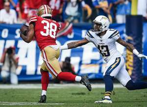 CARSON, CA - SEPTEMBER 30: Defensive back Antone Exum #38 of the San Francisco 49ers dodges wide receiver Keenan Allen #13 of the Los Angeles Chargers to score a touchdown in the first quarter at StubHub Center on September 30, 2018 in Carson, California. (Photo by Kevork Djansezian/Getty Images)