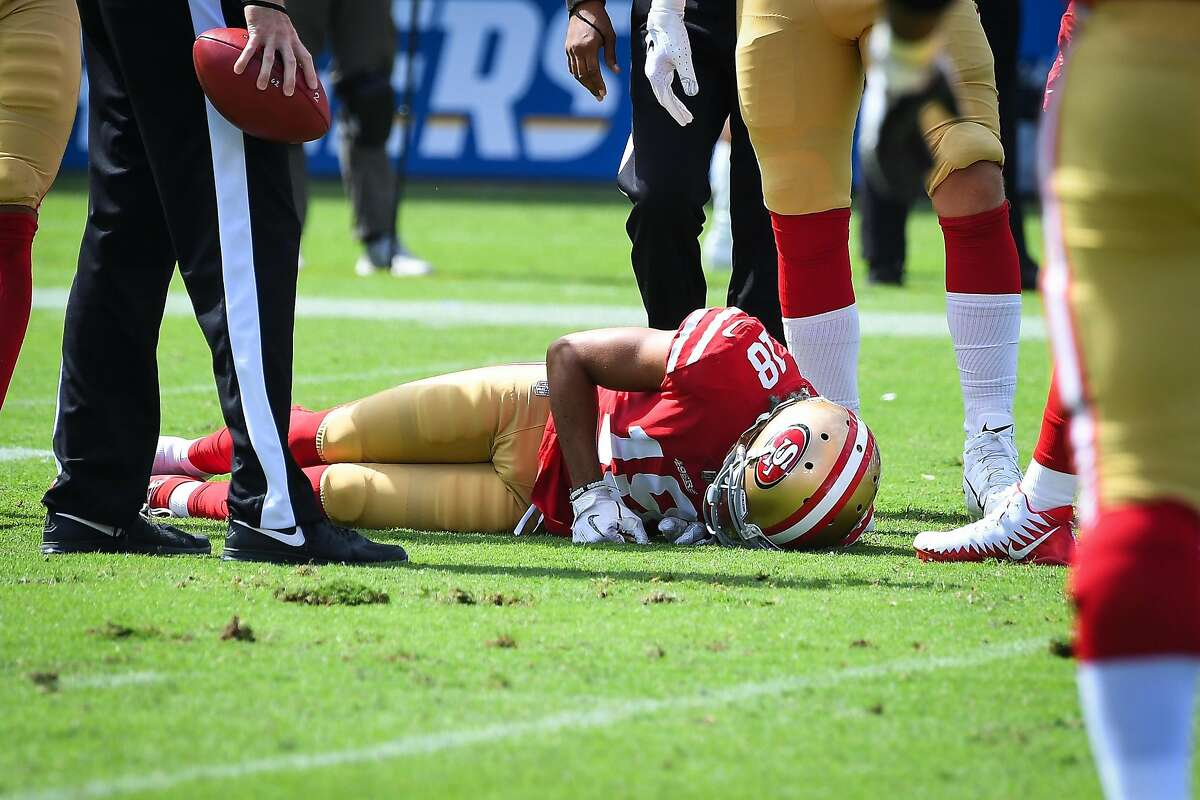 Wide receiver Dante Pettis #18 of the San Francisco 49ers is taken down and injured on the play in the first quarter against the Los Angeles Chargers at StubHub Center on September 30, 2018 in Carson, California.