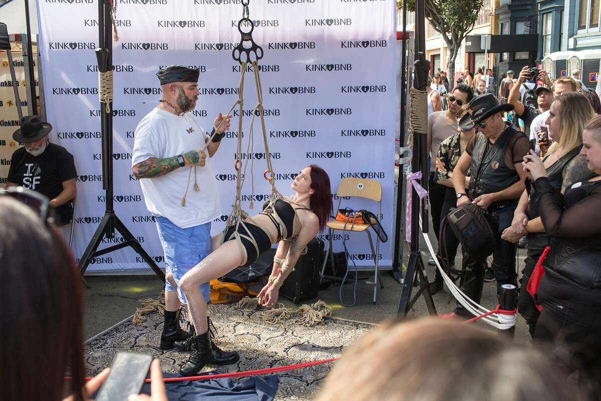 People watch a demonstration at the Kink BNB booth at the 35th annual Folsom Street Fair on Sunday, September 30, 2018 in San Francisco Calif.