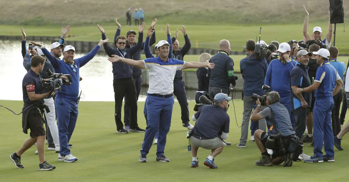 Europe's Jon Rahm, center, celebrates after Europe won the Ryder Cup on the final day of the 42nd Ryder Cup at Le Golf National in Saint-Quentin-en-Yvelines, outside Paris, France, Sunday, Sept. 30, 2018. (AP Photo/Matt Dunham)