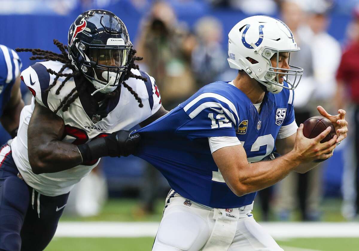 Houston Texans linebacker Jadeveon Clowney (90) sacks Indianapolis Colts quarterback Andrew Luck (12) during the first quarter of an NFL football game at Lucas Oil Stadium on Sunday, Sept. 30, 2018, in Indianapolis.