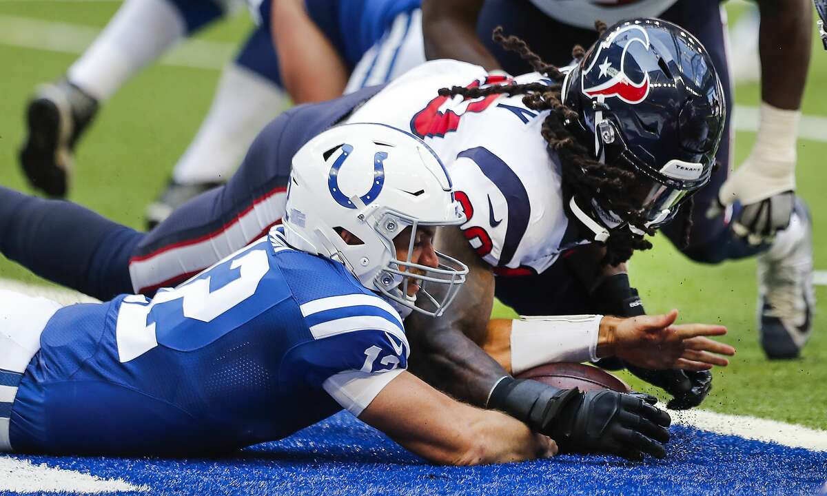 Houston Texans linebacker Jadeveon Clowney (90) falls on a fumble by Indianapolis Colts quarterback Andrew Luck (12) in the end zone for a touchdown during the first quarter of an NFL football game at Lucas Oil Stadium on Sunday, Sept. 30, 2018, in Indianapolis.