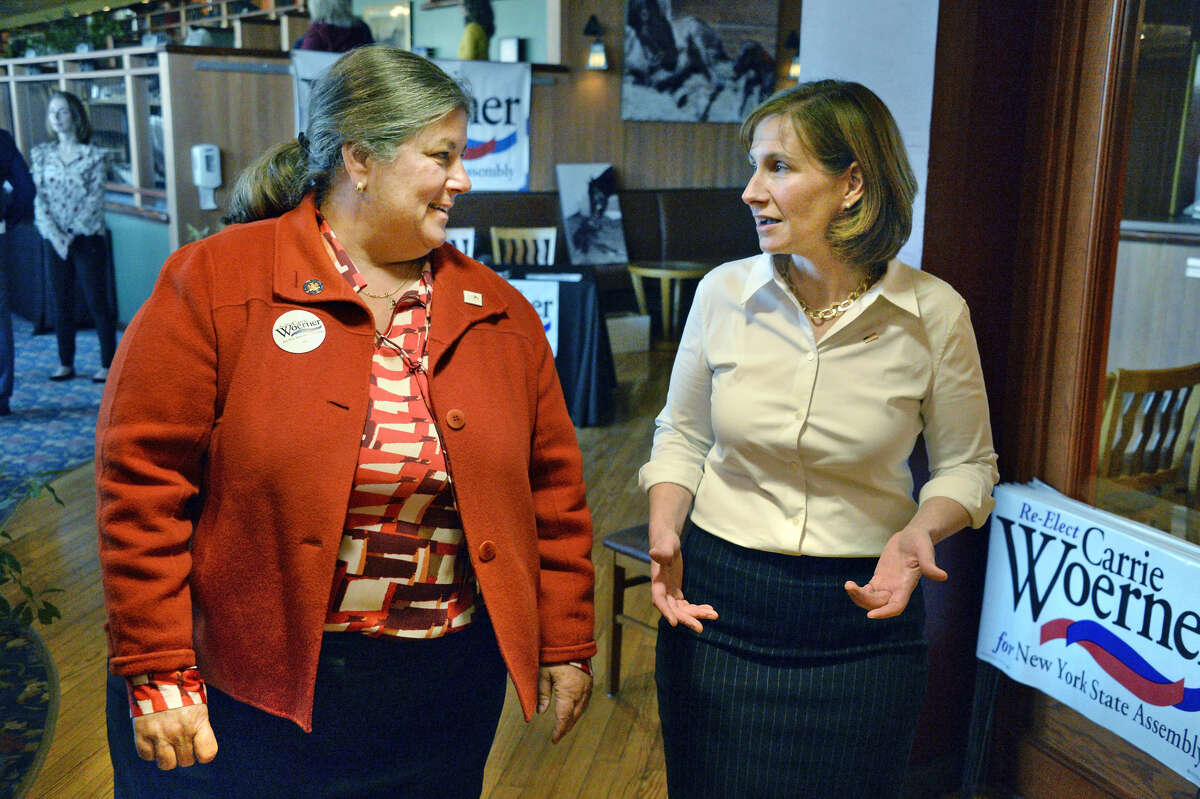 Assemblywoman Carrie Woerner, left, welcomes State Senate candidate Michele Ostrelich to her fundraiser Friday Sept. 28, 2018 in Saratoga Springs, NY. (John Carl D'Annibale/Times Union)