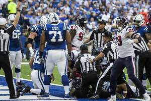 Houston Texans defensive end J.J. Watt (99) celebrates as linebacker Jadeveon Clowney's fumble recovery of a fumble by Indianapolis Colts quarterback Andrew Luck is called a touchdown during the first quarter of an NFL football game at Lucas Oil Stadium on Sunday, Sept. 30, 2018, in Indianapolis.
