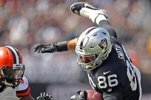 Oakland Raiders' Lee Smith flies for extra yardage in 2nd quarter against Cleveland Browns during NFL game at Oakland Coliseum in Oakland, Calif. on Sunday, September 30, 2018.