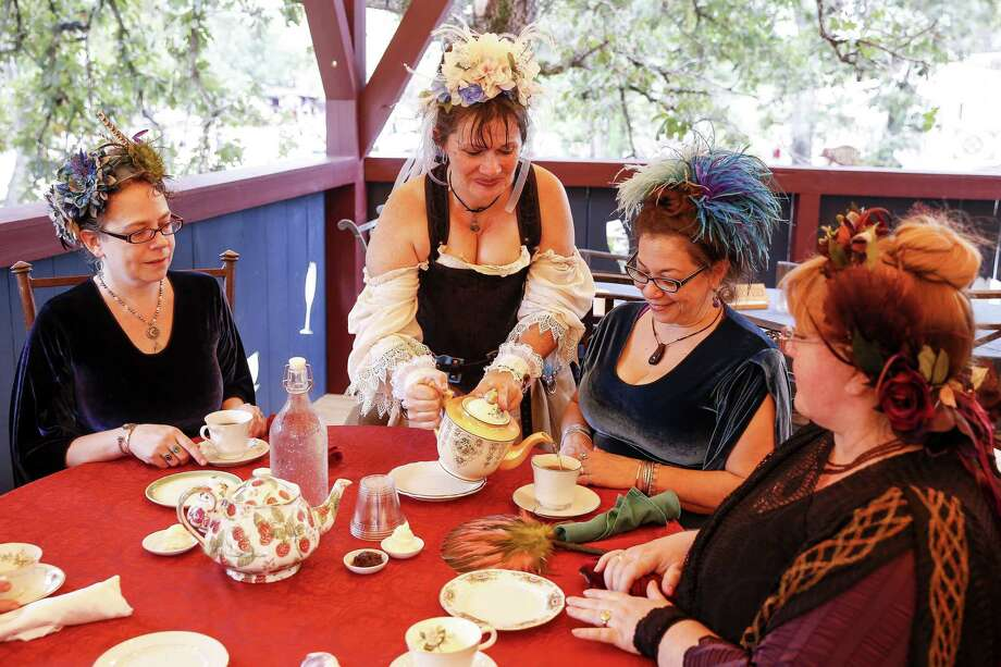 """Melinda Mercer, also know as """"Lady"""" Penelope Nichols Quartermaine, second from left, serves afternoon tea at during opening weekend of the Texas Renaissance Festival on Sunday Sept. 30, 2018. The renaissance festival runs Saturdays, Sundays and Thanksgiving Friday until November 25. Photo: Michael Ciaglo, Houston Chronicle / Staff Photographer / Michael Ciaglo"""