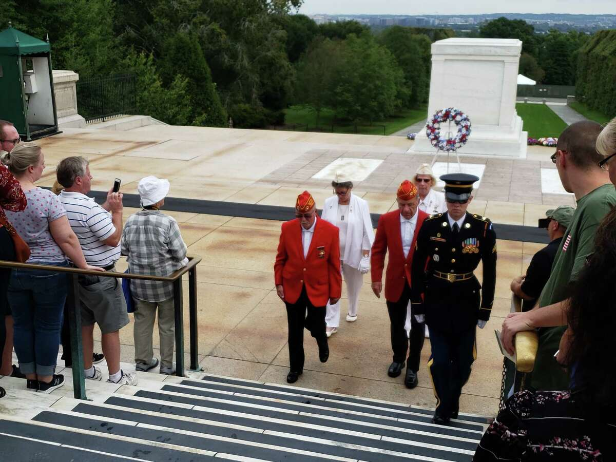Melody Burns Capt. William Dale O?Brien Detachment of Marine Corps League members John Nardolillo, left, and Michael J. Hoblock, as well as Gold Star Mothers Carrie Farley and Cindy Roberts step out after hey laid a wreath at the Tomb of the Unknown at the Arlington National Cemetery.