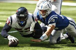 Houston Texans linebacker Duke Ejiofor (53) recovers a fumble by Indianapolis Colts quarterback Andrew Luck (12) during the second quarter of an NFL football game at Lucas Oil Stadium on Sunday, Sept. 30, 2018, in Indianapolis.