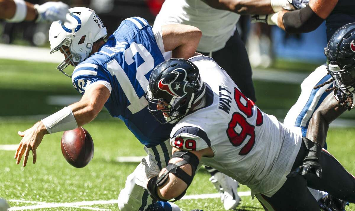 Houston Texans defensive end J.J. Watt (99) hits Indianapolis Colts quarterback Andrew Luck (12), forcing a fumble during the second quarter of an NFL football game at Lucas Oil Stadium on Sunday, Sept. 30, 2018, in Indianapolis.