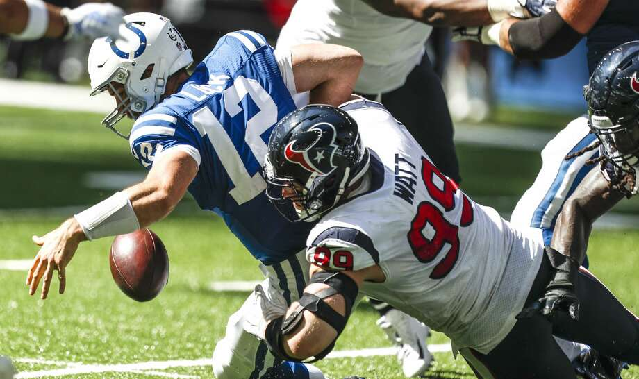 Houston Texans defensive end J.J. Watt (99) hits Indianapolis Colts quarterback Andrew Luck (12), forcing a fumble during the second quarter of an NFL football game at Lucas Oil Stadium on Sunday, Sept. 30, 2018, in Indianapolis. Photo: Brett Coomer/Staff Photographer