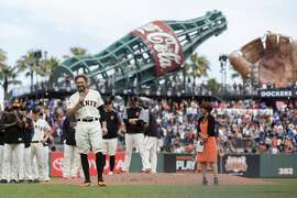 San Francisco Giants Hunter Pence talks to the fans to commemorate his career with the club after a baseball game against the Los Angeles Dodgers in San Francisco, Sunday, Sept. 30, 2018. (AP Photo/John Hefti)
