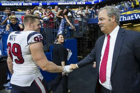 Houston Texans defensive end J.J. Watt (99) is greeted by Cal McNair, Texans chairman and chief operating officer, as he leaves the field following the Texans 37-34 overtime win over the Indianapolis Colts at Lucas Oil Stadium on Sunday, Sept. 30, 2018, in Indianapolis.