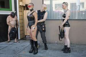 Mr. Torn (center) with Umile (left) and Zita (right) prepare to participate at the 35th annual Folsom Street Fair on Sunday, September 30, 2018 in San Francisco Calif.