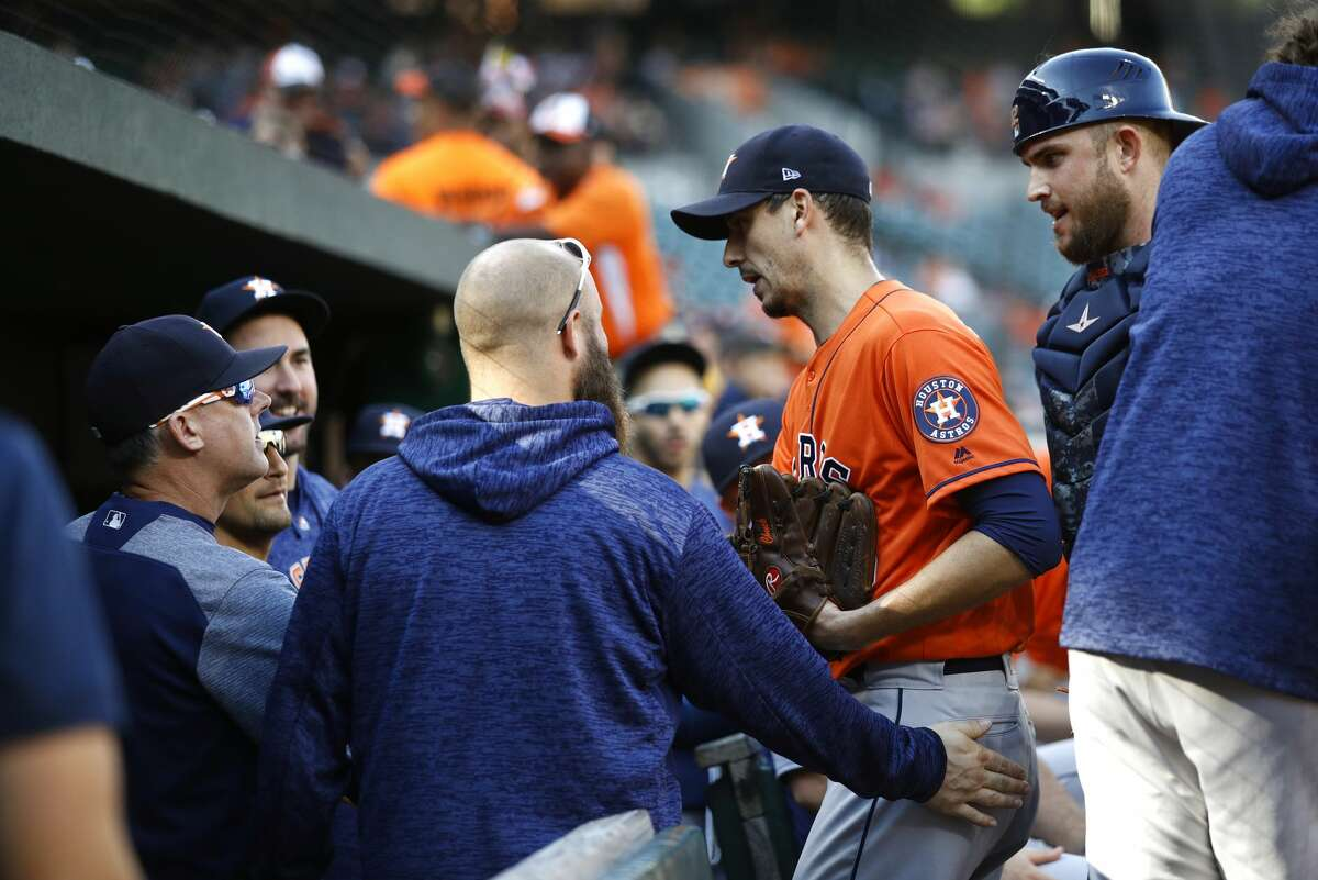 Houston Astros starting pitcher Charlie Morton, second from right, walks into the dugout in the third inning of a baseball game against the Baltimore Orioles, Sunday, Sept. 30, 2018, in Baltimore. (AP Photo/Patrick Semansky)