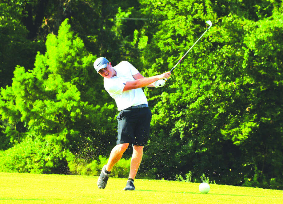Edwardsville junior Trevor Laub hits a tee shot on hole No. 17 at Belk Park Golf Course in Wood River during the Madison County Tournament on Aug. 16. Photo: Scott Marion
