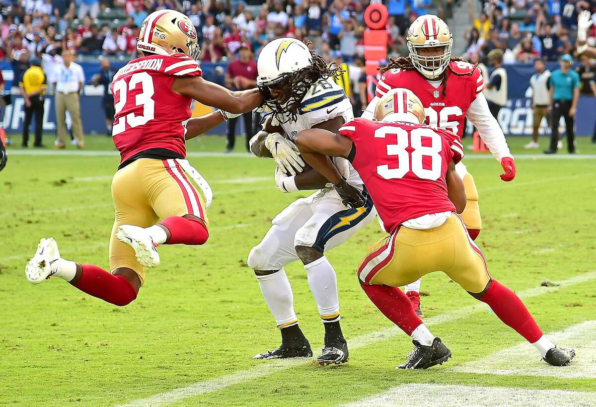 Cornerback Ahkello Witherspoon #23 and defensive back Antone Exum #38 of the San Francisco 49ers can't stop running back Melvin Gordon #28 of the Los Angeles Chargers as he rushes into the end zone for a touchdown in the third quarter of the game at StubHub Center on September 30, 2018 in Carson, California.