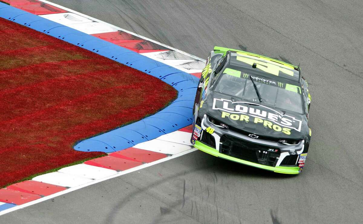 Jimmie Johnson (48) runs over the rumble strips in Turn 16 during the NASCAR Cup series auto race at Charlotte Motor Speedway in Concord, N.C., Sunday, Sept. 30, 2018. (AP Photo/Mike McCarn)