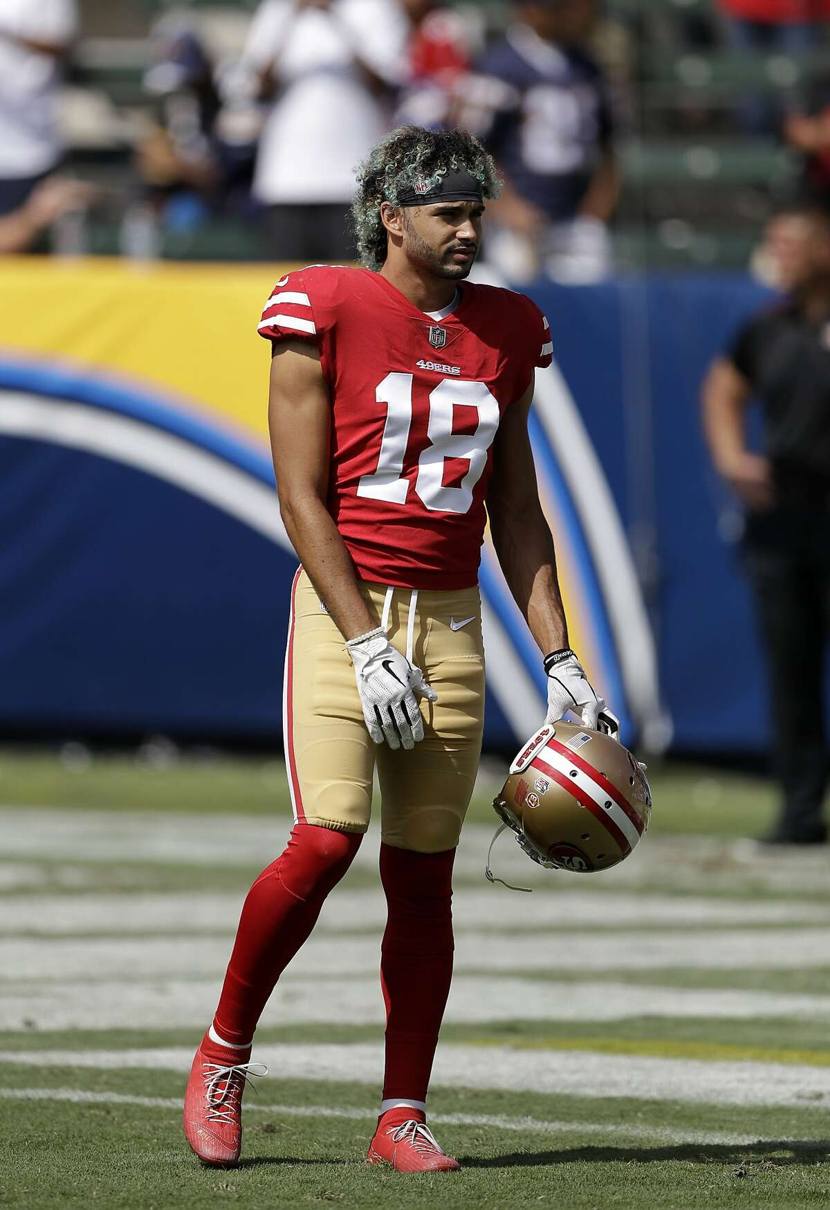San Francisco 49ers wide receiver Dante Pettis warms up prior to an NFL football game against the Los Angeles Chargers, Sunday, Sept. 30, 2018, in Carson, Calif. (AP Photo/Marcio Sanchez)
