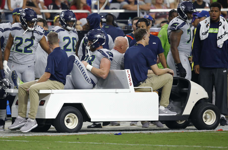 Tight end Will Dissly was injured in the first quarter of the Seahawks' win over the Cardinals on Sunday. According to reports, he's out for the year with a torn patella.  Photo: Ross Franklin/Associated Press