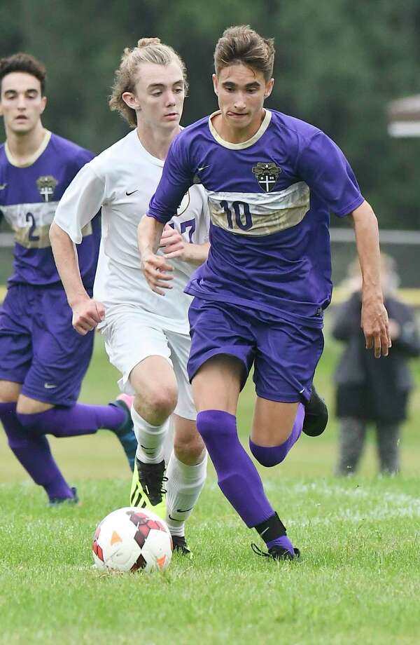 Christian Brothers Academy's Keegan Vedder (10) moves the ball past Ballston Spa's Jeff Matthews (47) during a Section II boys' soccer game Tuesday, Sept. 11, 2018, in Niskayuna, N.Y. (Hans Pennink / Special to the Times Union) Photo: Hans Pennink / Hans Pennink