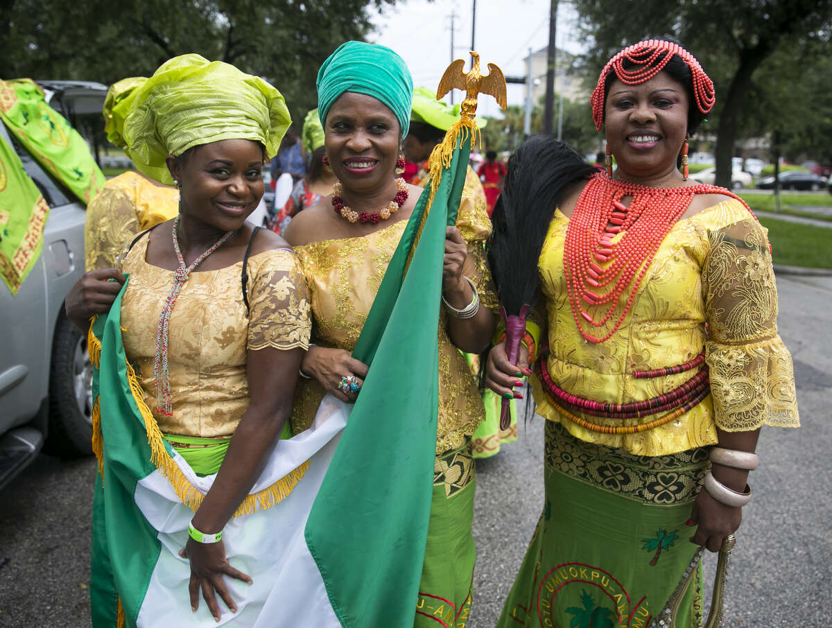 Members of the Otu-Umuokpu Anambra USA Association Inc. prepare before participating in the second annual Nigeria Cultural Day Parade on Saturday, September 29, 2018, in downtown Houston.