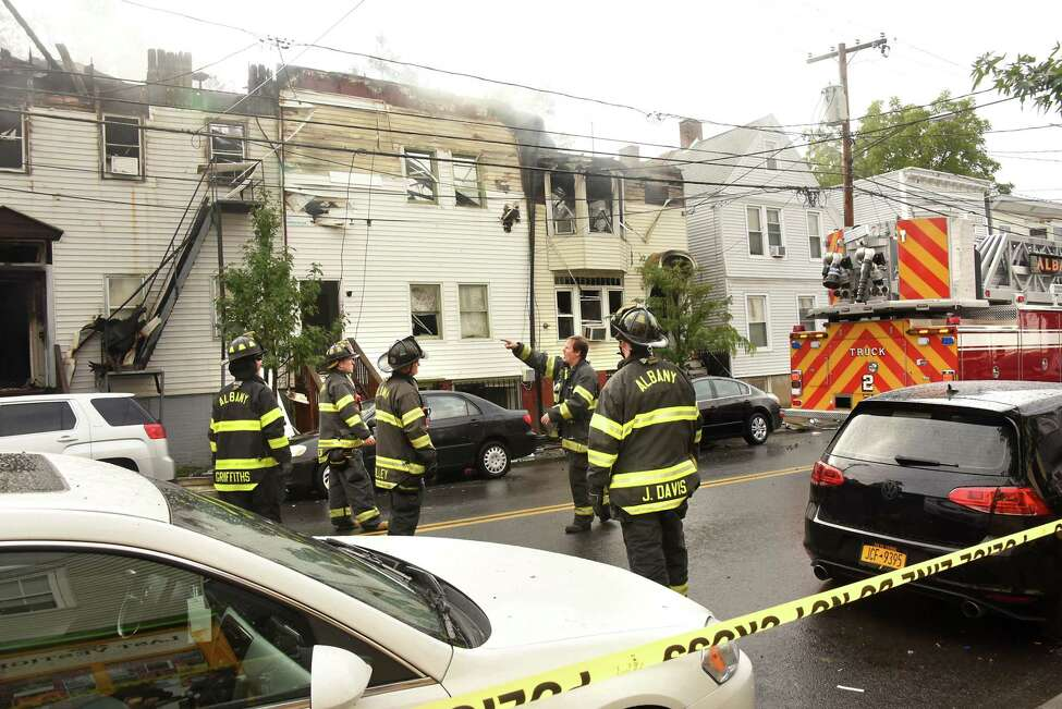 Firefighters work to extinguish a multi-home fire on Quail St. on Sunday, Sept. 30, 2018 in Albany, N.Y. The fire started about 4:40 AM. (Lori Van Buren/Times Union)