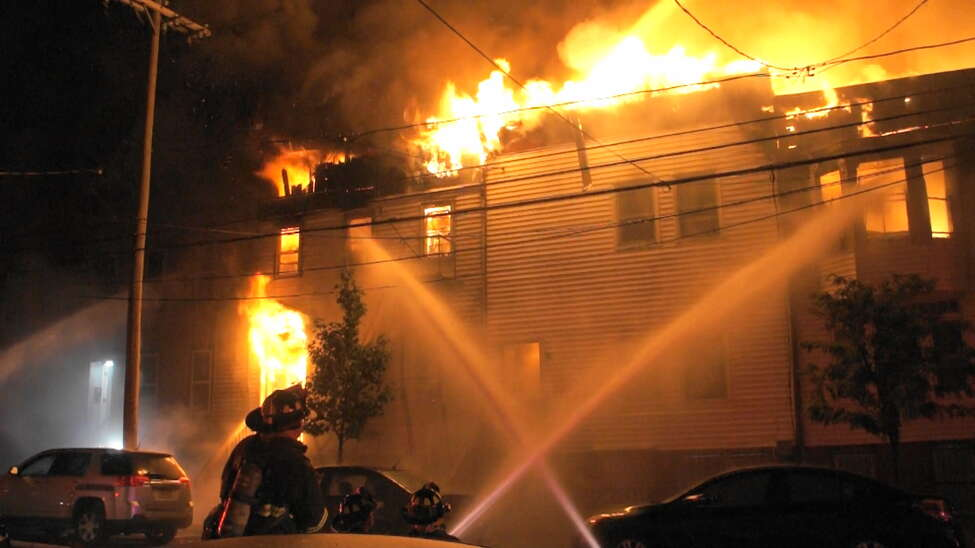 Firefighters battled a fire on Quail Street early Sunday, Sept. 30, 2018. The fire destroyed six buildings, and happened only an hour after at least another six buildings were destroyed on Sheridan Avenue in a separate blaze. (Martin E. Miller/Special to the Times Union)