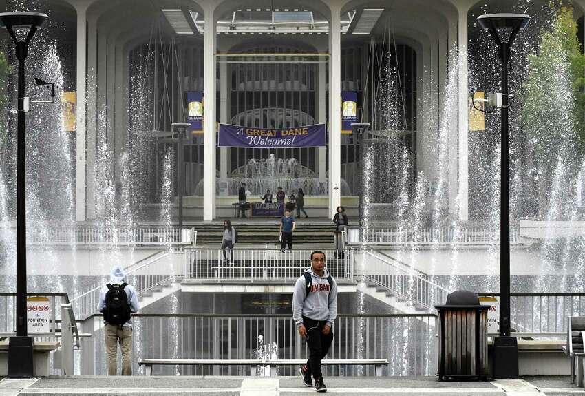 Students move between classes at the University at Albany campus on Friday Sept. 29, 2018, in Albany, N.Y. (Will Waldron/Times Union)