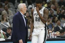 San Antonio Spurs' head coach Gregg Popovich talks with Rudy Gay during the second half at the AT&T Center, Sunday, Sept. 30, 2018. The Spurs won their first preseason game, 104-100.