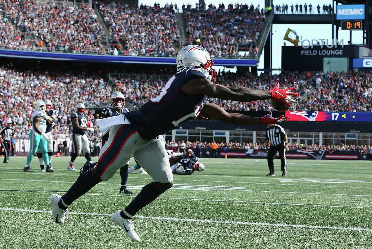 FOXBOROUGH, MA - SEPTEMBER 30: Phillip Dorsett #13 of the New England Patriots catches a touchdown pass during the second quarter against the Miami Dolphins at Gillette Stadium on September 30, 2018 in Foxborough, Massachusetts. (Photo by Jim Rogash/Getty Images)