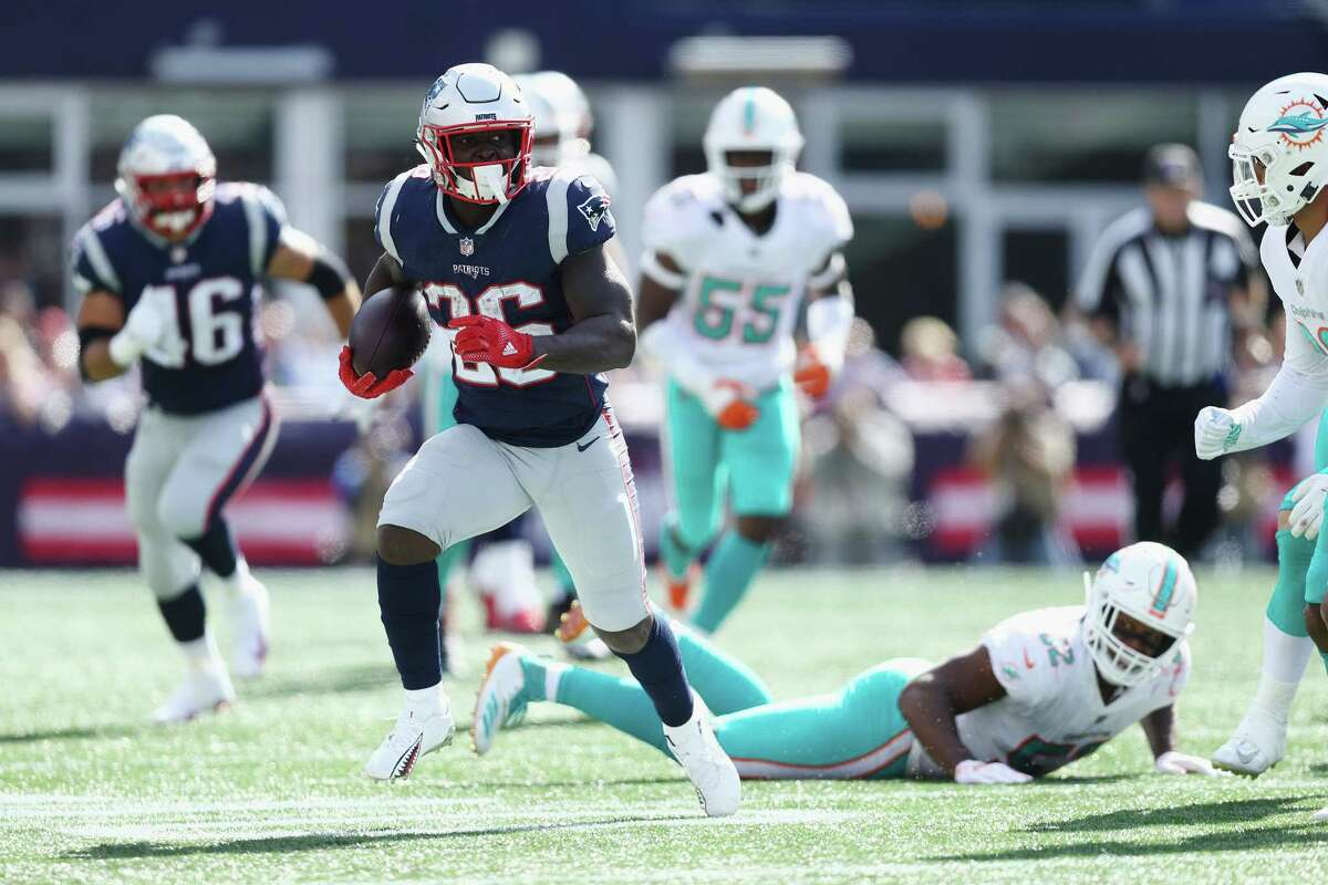 FOXBOROUGH, MA - SEPTEMBER 30: Sony Michel #26 of the New England Patriots runs with the ball during the first half against the Miami Dolphins at Gillette Stadium on September 30, 2018 in Foxborough, Massachusetts. (Photo by Maddie Meyer/Getty Images)