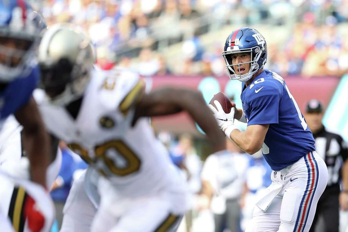 EAST RUTHERFORD, NJ - SEPTEMBER 30: Eli Manning #10 of the New York Giants looks to pass during the first quarter against the New Orleans Saints at MetLife Stadium on September 30, 2018 in East Rutherford, New Jersey. (Photo by Elsa/Getty Images)