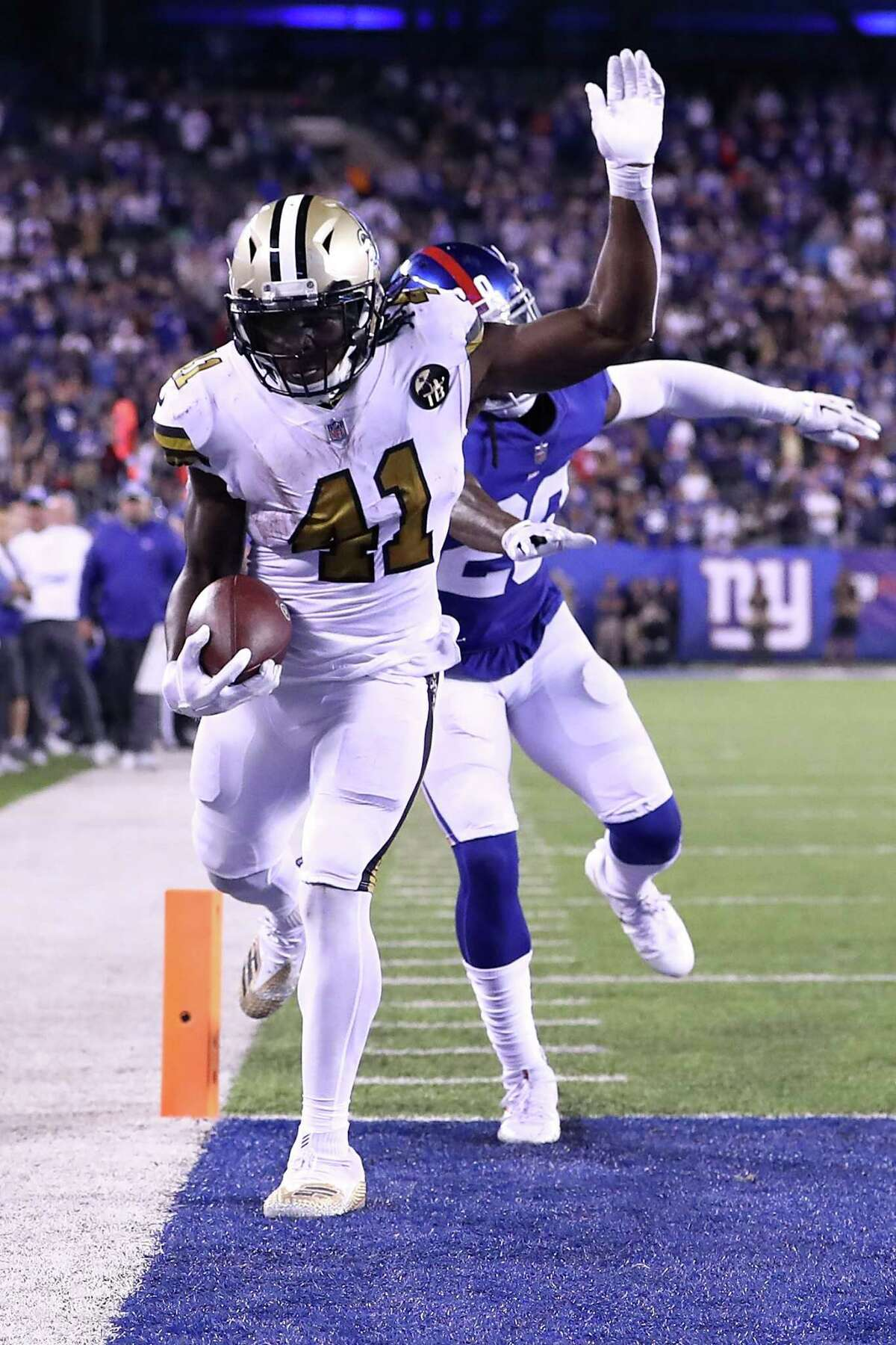 EAST RUTHERFORD, NJ - SEPTEMBER 30: Alvin Kamara #41 of the New Orleans Saints scores a touchdown against the New York Giants during the fourth quarter at MetLife Stadium on September 30, 2018 in East Rutherford, New Jersey. (Photo by Al Bello/Getty Images)
