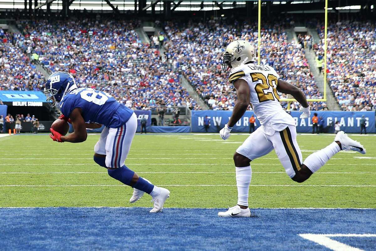 EAST RUTHERFORD, NJ - SEPTEMBER 30: Sterling Shepard #87 of the New York Giants makes a touchdown reception during the first quarter against the New Orleans Saints at MetLife Stadium on September 30, 2018 in East Rutherford, New Jersey. (Photo by Elsa/Getty Images)