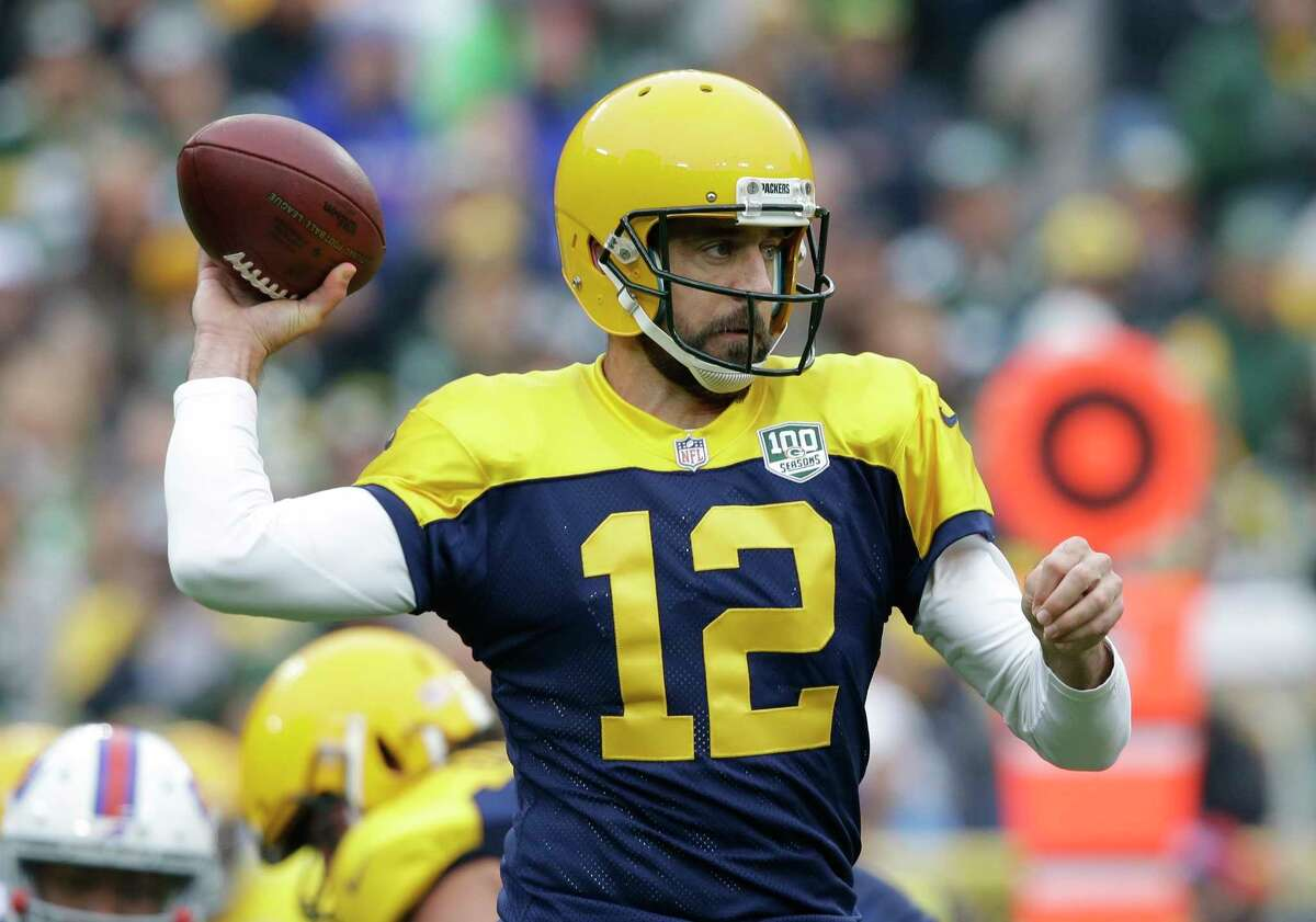 Green Bay Packers' Aaron Rodgers- drops back during the first half of an NFL football game against the Buffalo Bills Sunday, Sept. 30, 2018, in Green Bay, Wis. (AP Photo/Jeffrey Phelps)
