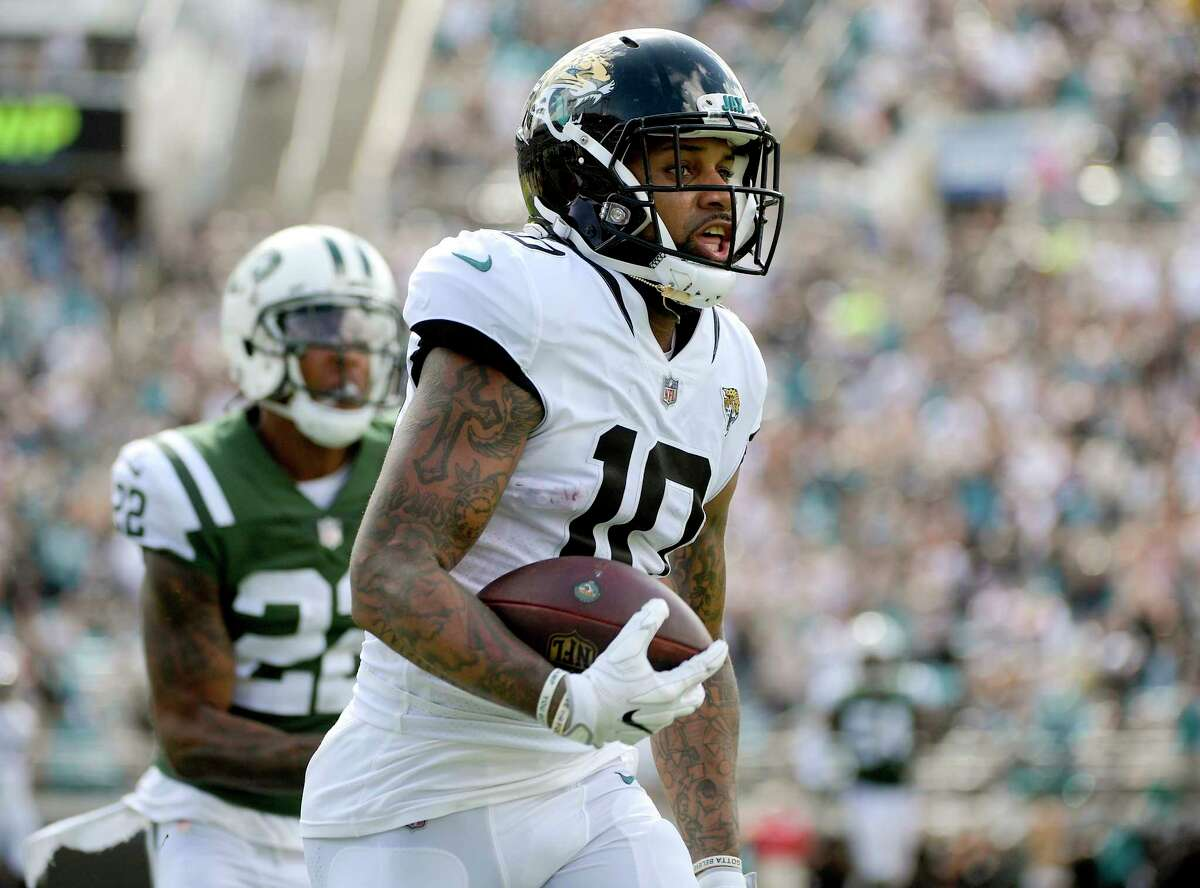 Jacksonville Jaguars wide receiver Donte Moncrief (10) runs for a 67-yard touchdown on a pass play in front of New York Jets cornerback Trumaine Johnson (22) during the second half of an NFL football game, Sunday, Sept. 30, 2018, in Jacksonville, Fla. (AP Photo/Phelan M. Ebenhack)