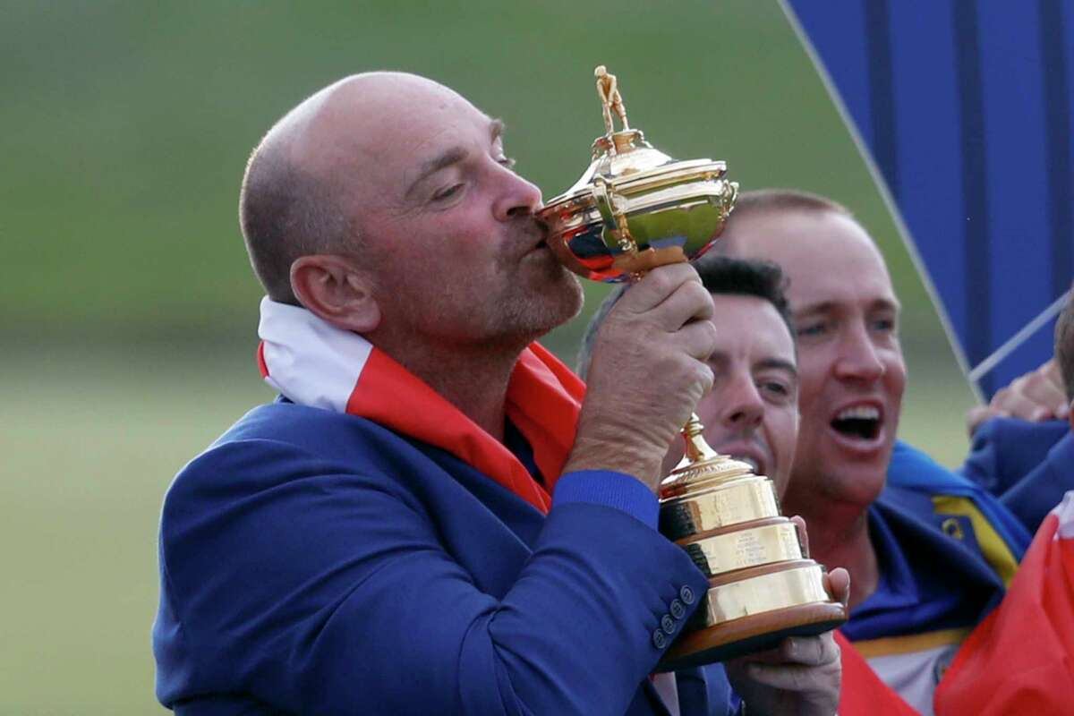 Europe team captain Thomas Bjorn kisses the cup during the trophy presentation after the European team won the 2018 Ryder Cup golf tournament at Le Golf National in Saint Quentin-en-Yvelines, outside Paris, France, Sunday, Sept. 30, 2018. (AP Photo/Alastair Grant)