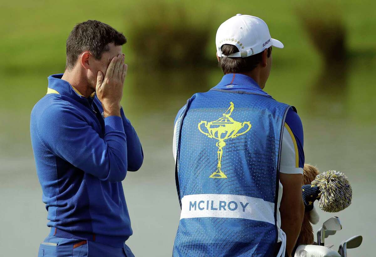 Europe's Rory McIlroy reacts on the 18th hole after a singles match on the final day of the 42nd Ryder Cup at Le Golf National in Saint-Quentin-en-Yvelines, outside Paris, France, Sunday, Sept. 30, 2018. Europe's Rory McIlroy lost to Justin Thomas of the US. (AP Photo/Matt Dunham)