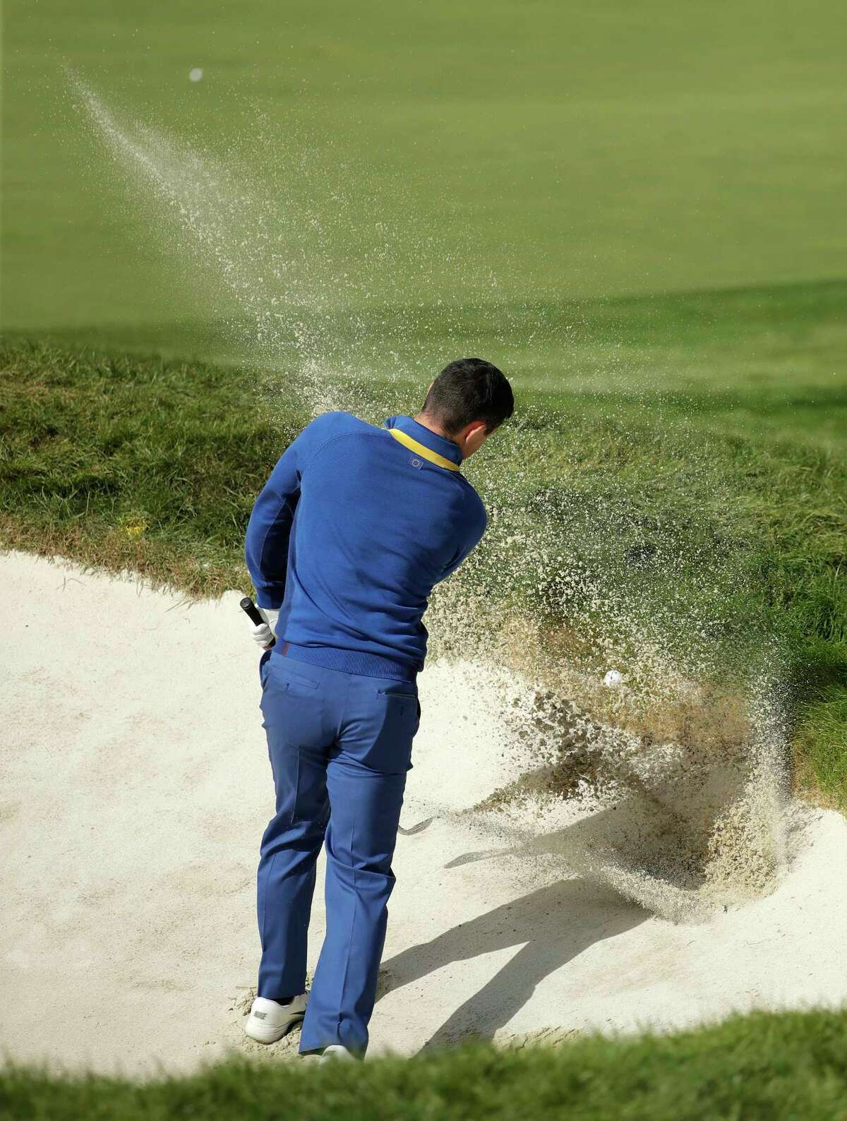 Europe's Rory McIlroy fails to get out of a bunker on the 18th hole during a singles match on the final day of the 42nd Ryder Cup at Le Golf National in Saint-Quentin-en-Yvelines, outside Paris, France, Sunday, Sept. 30, 2018. Europe's Rory McIlroy lost to Justin Thomas of the US. (AP Photo/Matt Dunham)