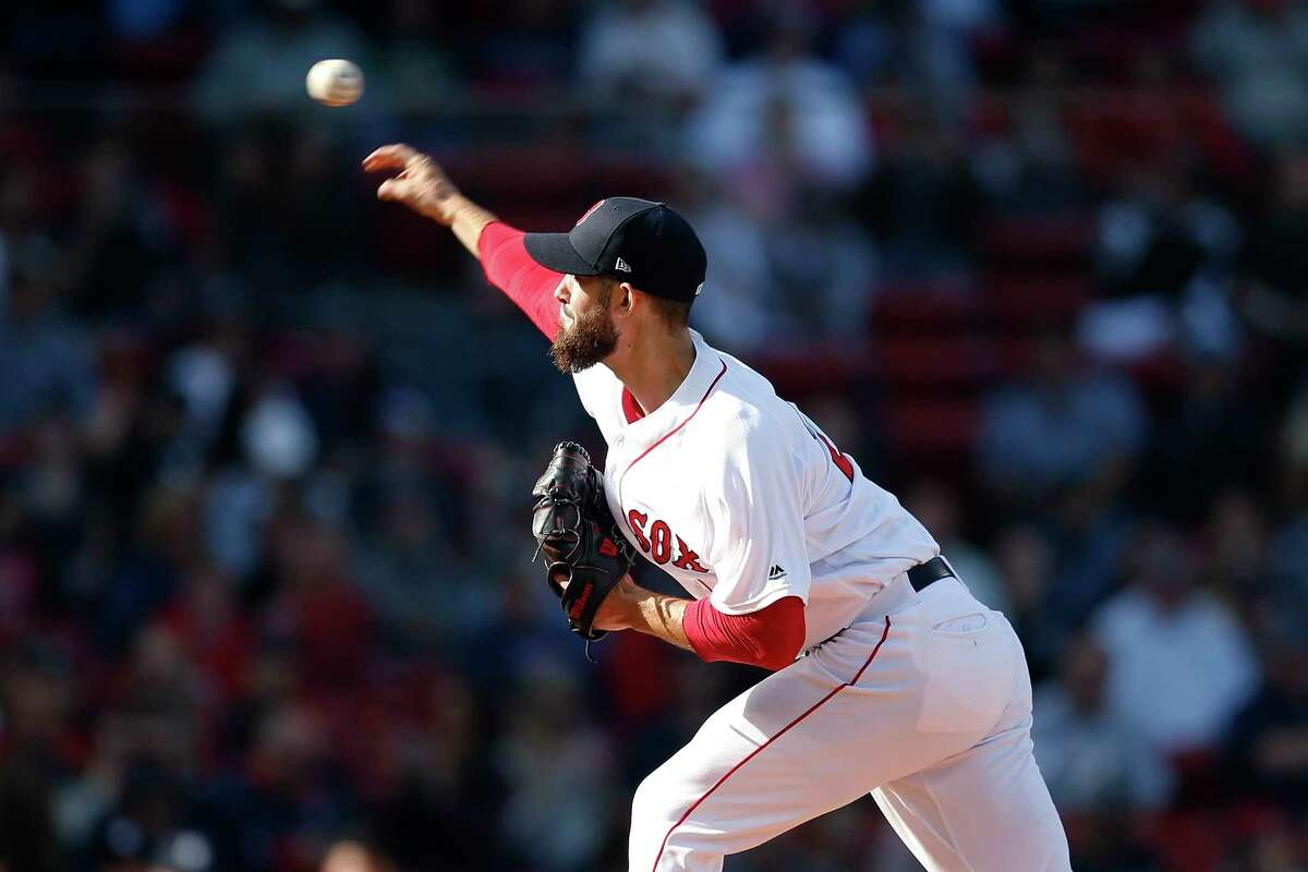 Boston Red Sox's Rick Porcello pitches during the first inning of a baseball game against the New York Yankees in Boston, Sunday, Sept. 30, 2018. (AP Photo/Michael Dwyer)