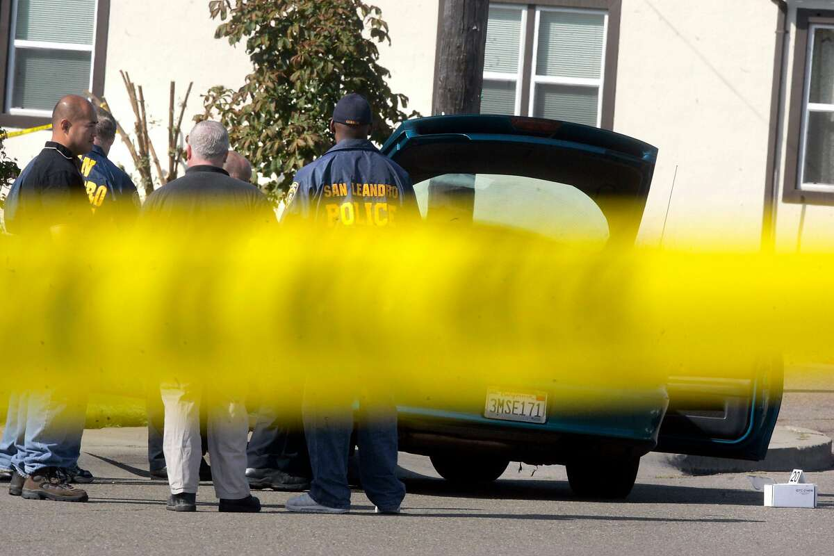 shooting_039_mc.jpg Scene of apparent murder-suicide in San Leandro near 137th Ave. and Wake. The car in the picture, seen through crime scene tape, is apparently where the shootings transpired. PHOTO: Mark Costantini/San Francisco Chronicle