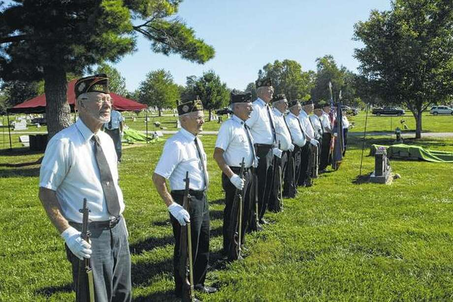 Members of the Combined Veterans Ceremonial Team, or honor guard, stand at attention recently prior to a military-style funeral at Jacksonville East Cemetery. The group conducts a military-style graveside ceremony about 50 times a year. Photo: Greg Olson | Journal-Courier