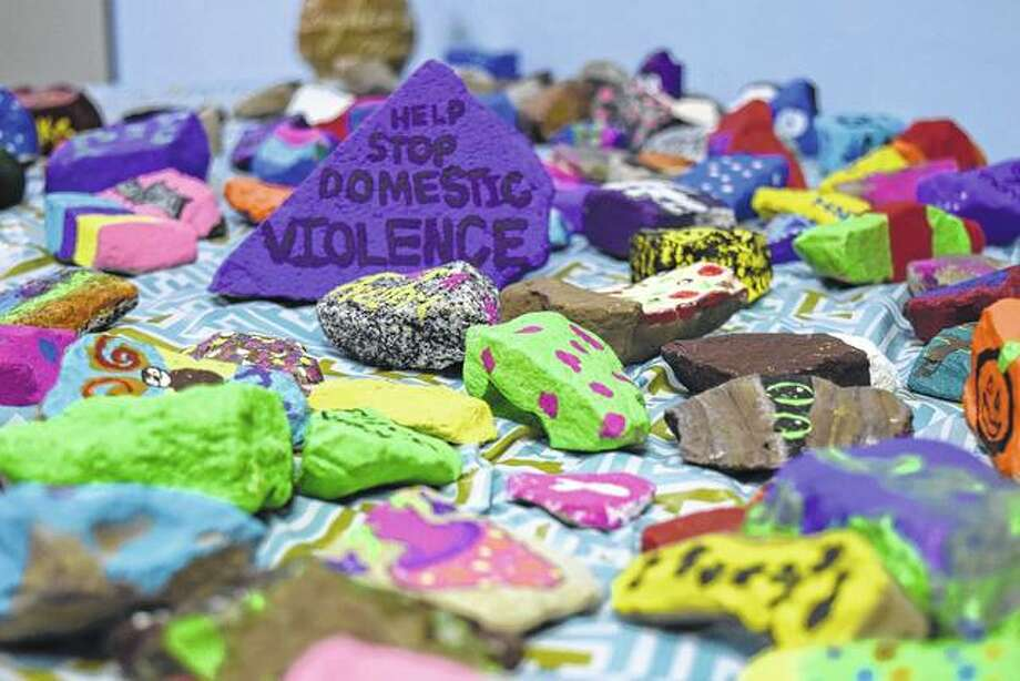 Rocks painted by Crisis Center Foundation clients will be hidden throughout the center's four-county service area and have messages to help spread awareness about domestic violence. Photo: Nick Draper | Journal-Courier