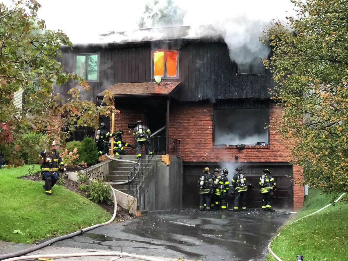 Flames consumed a home Monday morning on Colonial Avenue in Albany. The flames spread throughout the building and firefighters eventually had to retreat from inside the structure to be safe.